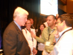 Bob Metcalfe, left, talks with audience members at the Clean Energy Venture Summit 2011 in Austin, following his speech
