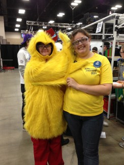 Lauralee Kalinec with the Screaming Chicken mascot for her robotics team.