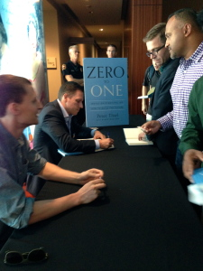 Peter Thiel signing books with Blake Masters, his co-author and former student.