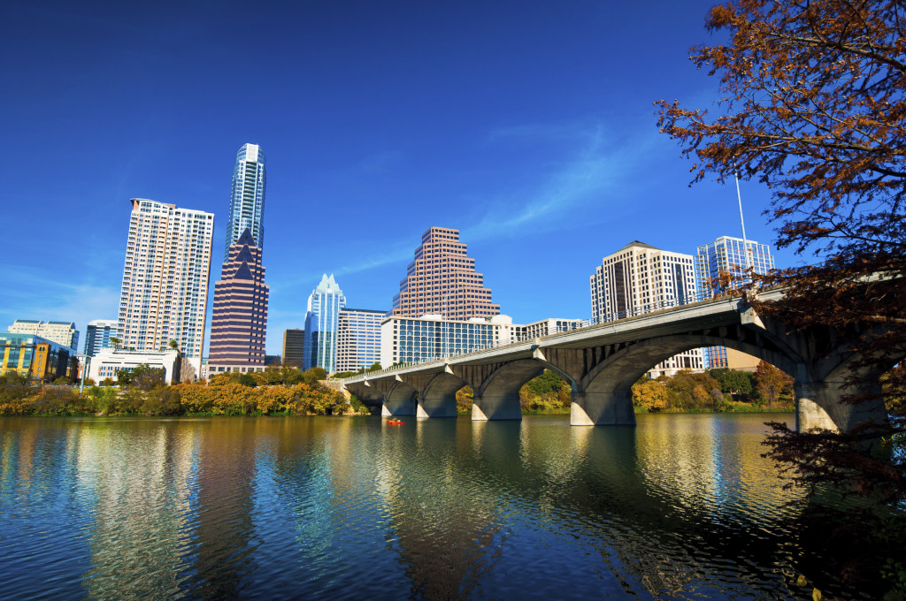 Austin downtown skyline, bridge, lake, and fall trees
