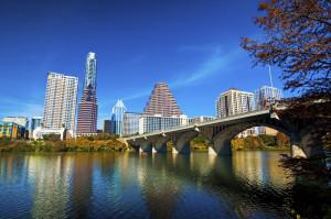 Austin downtown skyline, bridge, lake, and fall trees