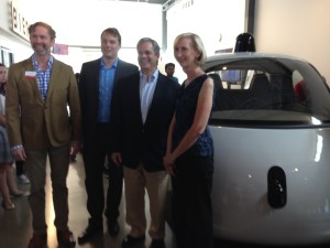 Troy Livingston, CEO, The Thinkery, Chris Urmson, Director, Google Self-Driving Car Project, Austin Mayor Steve Adler and City Councilwoman Ann Kitchen in front of the Google autonomous car prototype
