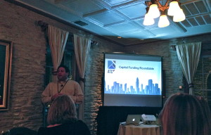 David Altounian presenting data on funding deals in Austin.