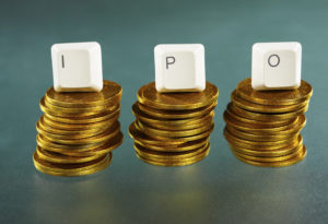 IPO letter on each block over gold coins stacks