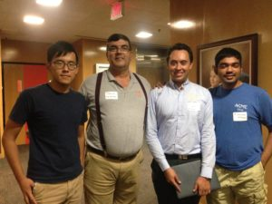 "(Second from the left) Benito Fernandez, associate professor in the department of mechanical engineering, presented ""CHECK,"" a chaotic hybrid encryption communications kit. Pictured with his students."